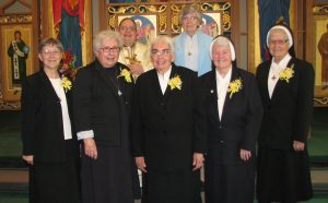!st Row: Sr. Susan, Sr. Seraphim, Sr. Melita Marie, Sr. Regina and Sr. Bernarda. 2nd Row: Father Michael Huszti and Sr. Ruth, Provincial.