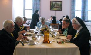 Jubilarians enjoy a celebratory meal with Sr. Ruth and Father Michael.