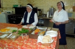 Lunch is served by hostesses Sr. Salome and Sr. Agnes