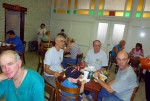 Volunteers relaxing and talking over lunch
