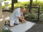 Father John Petro painting the steps