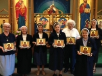 The Sisters display their icons
